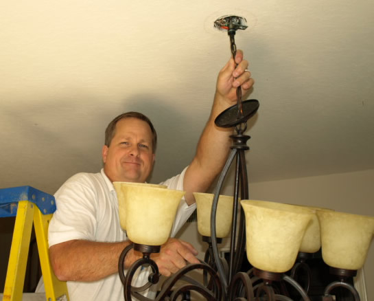 Lighting Thousand Oaks Electrical Contractor Installing Chandelier